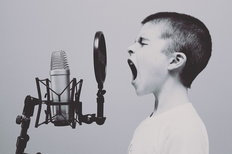boy shouting at a microphone